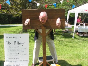 A miscreant in the pillory at the Garden Party.